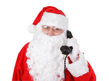 Santa claus receives a phone call. On white background royalty free stock images