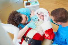 Santa Claus at a reception at the dentist`s office in the Christ. Mas, New Year royalty free stock image