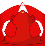 Santa Claus and red bag. Big sack with gifts. Giving gifts at Ch Stock Photo