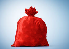 Santa Claus red bag full, on blue background Royalty Free Stock Photography
