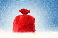 Santa Claus red bag full, on snow background Stock Photography