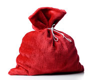 Santa Claus red bag full, on white background. Royalty Free Stock Images