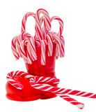 Santa Claus red boot, shoe with colored sweet lollipops, candys. Saint Nicholas boot with presents gifts. Stock Images