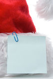 Santa claus red cap with note Royalty Free Stock Photos