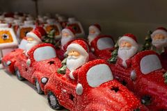 Santa Claus on a red car, a set of festive toys in the store. stock images