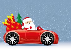 Santa claus in the red car. Santa claus in the red car on a winter background Stock Photo