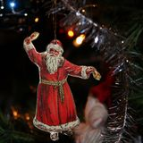 Santa Claus. A red dressed as Santa Claus in a Christmas tree Royalty Free Stock Photo