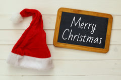 Santa claus red hat and blackboard on white background Stock Photos