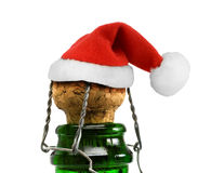 Santa Claus red hat in Champagne Bottle Stock Images