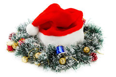 Santa Claus red hat and Christmas Wreath Royalty Free Stock Photography