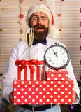 Santa Claus in red hat with confused face. Celebration concept. Santa Claus in red hat with confused face. Celebration and decor concept. Guy near Christmas tree stock photos