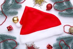 Santa Claus red hat and gifts on white background. Christmas decoration royalty free stock photo