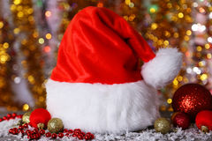 Santa Claus red hat on lights background. Stock Image