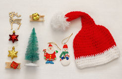 Santa claus red hat next to christmas decorations Stock Photography