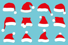 Santa Claus red hat set on blue Royalty Free Stock Photos