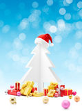 Santa Claus red hat on top of christmas tree Royalty Free Stock Photography