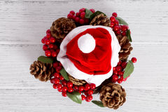 Santa claus red hat. On white wood background Royalty Free Stock Image