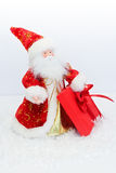 Santa Claus in a red kaftan holding a red gift box Stock Photo