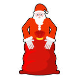 Santa Claus and red sack. Big bag with gifts. Giving gifts at Ch Royalty Free Stock Image