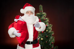 Santa Claus with red sack Royalty Free Stock Photography
