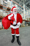 Santa Claus with red sack in storehouse stock image