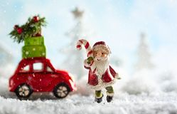 Santa Claus and red toy car carrying Christmas gifts in snowy la. Ndscape. Christmas concept with copy space royalty free stock images