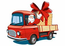Santa Claus on red truck delivers gifts. Stock Photo