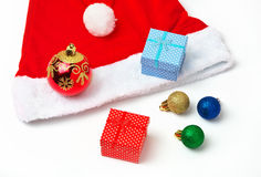 Santa Claus red and white hat, bubbles and christmas gifts Stock Photography