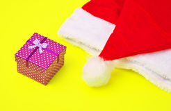 Santa Claus red and white hat and christmas gift Royalty Free Stock Photo