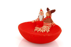 Santa Claus and reindeer Stock Images