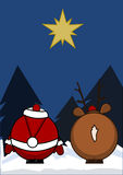 Santa Claus and reindeer. Look at a star Royalty Free Stock Image