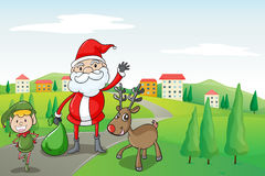 A santa claus and a reindeer Stock Image