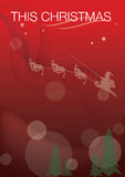 Santa Claus and reindeer. A Christmas graphic with a red wintry background of Santa Clause and reindeer flying and pulling a sleigh over evergreen trees Stock Photo