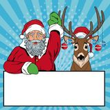Santa claus with reindeer and banner Christmas pop art. Vector illustration graphic Stock Image