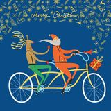 Santa Claus and reindeer cyclists christmas illustration. Vector illustration with cute Santa Claus and deer on city bicycle with gift box in basket and doodle Royalty Free Stock Photography
