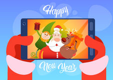 Santa Claus With Reindeer Elfs Making Selfie Photo, New Year Christmas Holiday Greeting Card Stock Photos