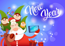 Santa Claus With Reindeer Elfs Making Selfie Photo, New Year Christmas Holiday Greeting Card Stock Photo