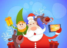 Santa Claus With Reindeer Elfs Making Selfie Photo, New Year Christmas Holiday Greeting Card Stock Image