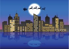 Santa Claus and reindeer fly over the city at the night with lot Stock Images