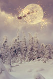 Santa Claus with reindeer flying through the sky. Stock Image