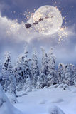 Santa Claus with reindeer flying through the sky. Royalty Free Stock Photos