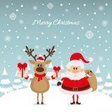 Santa Claus and reindeer with gifts Stock Photo