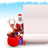 Santa claus with reindeer and gifts on iceland Stock Photos