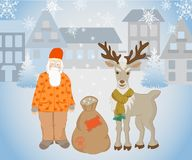 Santa Claus and reindeer with gifts Stock Photography