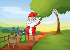 A santa claus and a reindeer Royalty Free Stock Photo