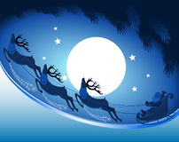 Santa Claus with reindeer in the night sky in the Christmas night. Royalty Free Stock Image