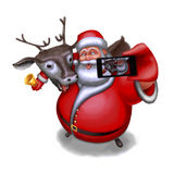 Santa Claus and reindeer are photographed on a smartphone Royalty Free Stock Photo