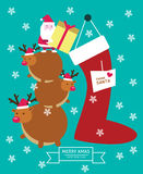 Santa Claus and reindeer putting gift into big sock. christmas and New year. Stock Photos