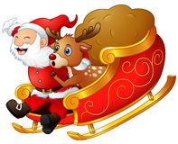 Santa claus and a reindeer riding his sleigh and carry huge sack Royalty Free Stock Photos