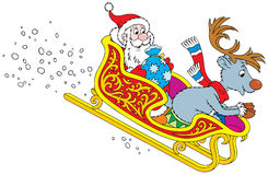 Santa Claus and Reindeer rush in the sledge Stock Photo